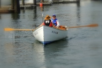 Some other friends borrowed the owner of the sailobat's rowboat to practice....