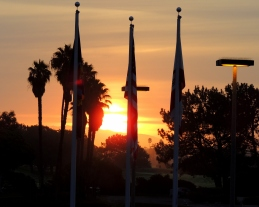 Three patriotic flags standing proud at sunrise.....