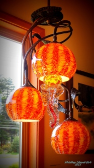Three jelly lamps on a chandelier!